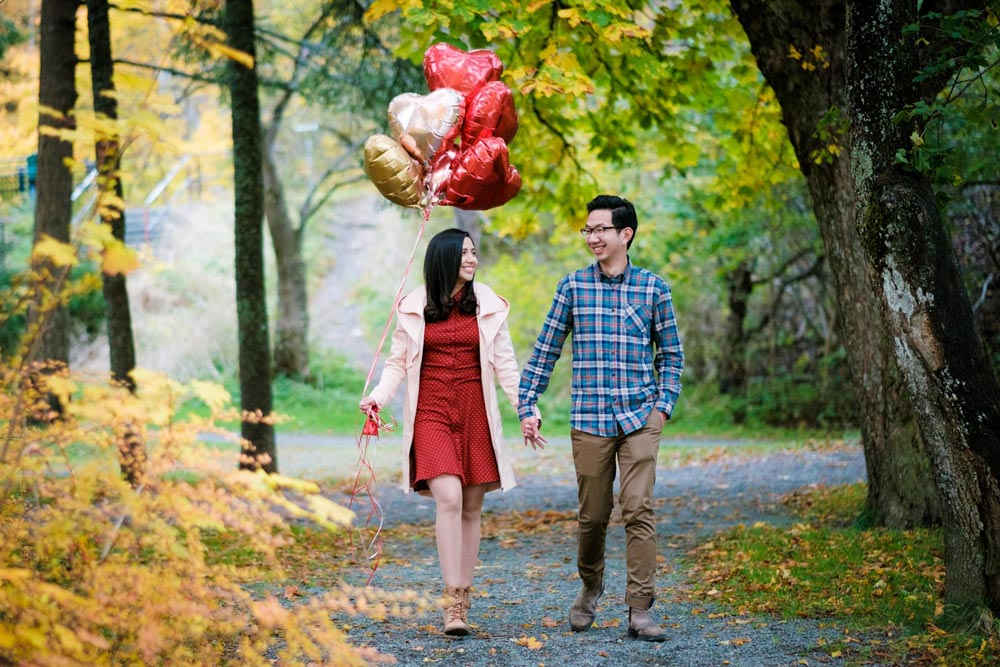 engaged-couple-walking-in-bowring-park-after-proposal