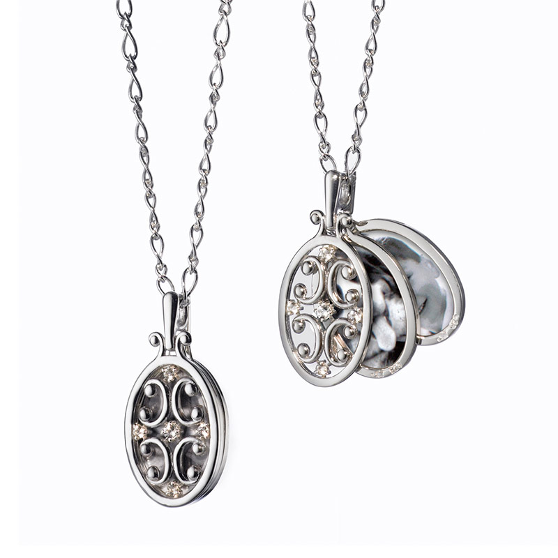"""Monica Rich Kosann Sterling Silver Oval Gate Frame Necklace with Two Image Cases and White Sapphire Stones on 30"""" Chain."""